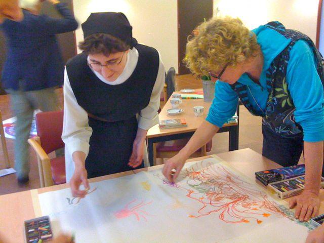 Octaafspel Jacqueline en Guerric tekenen